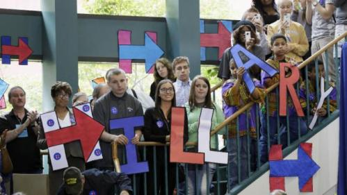 Audience members listen as Democratic presidential candidate Hillary Rodham Clinton speaks during a community forum, Tuesday, Oct. 6, 2015, in Davenport, Iowa. (AP Photo/Charlie Neibergall)