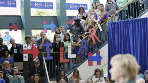 Audience members look on as Democratic presidential candidate Hillary Rodham Clinton speaks during a community forum, Tuesday, Oct. 6, 2015, in Davenport, Iowa. (AP Photo/Charlie Neibergall)