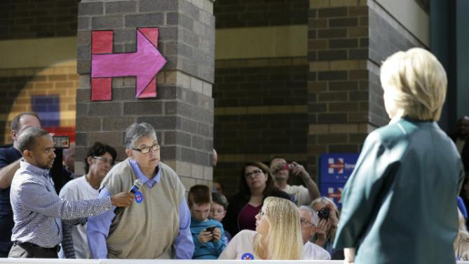 Dr. Chris Hendricks, of Davenport, Iowa, asks Democratic presidential candidate Hillary Rodham Clinton a question during a community forum, Tuesday, Oct. 6, 2015, in Davenport, Iowa. (AP Photo/Charlie Neibergall)