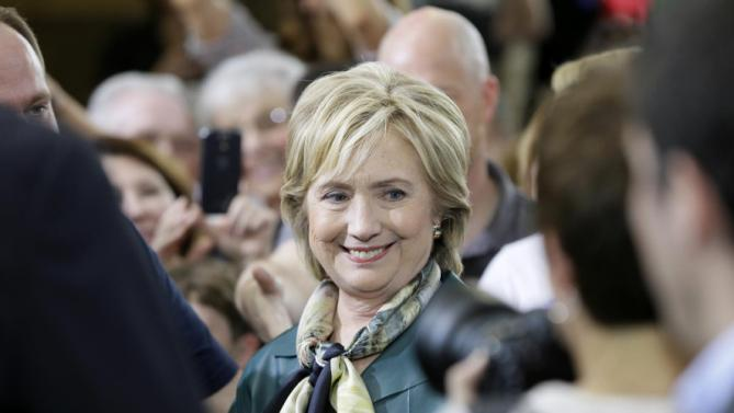 Democratic presidential candidate Hillary Rodham Clinton greets audience members following a community forum, Tuesday, Oct. 6, 2015, in Davenport, Iowa. (AP Photo/Charlie Neibergall)