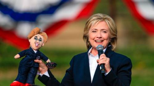 Democratic presidential candidate Hillary Rodham Clinton holds up a doll that was handed to her from the audience Wednesday, Oct. 7, 2015, during a campaign stop at the Westfair Amphitheater in Council Bluffs, Iowa. (AP Photo/Nati Harnik)