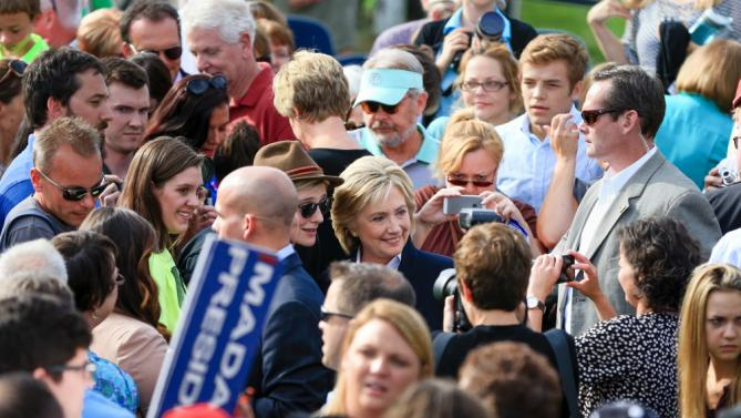 Democratic presidential candidate Hillary Rodham Clinton poses for a photo Wednesday, Oct. 7, 2015, following a campaign stop at the Westfair Amphitheater in Council Bluffs, Iowa. (AP Photo/Nati Harnik)