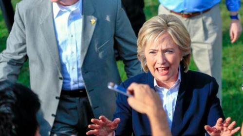 Democratic presidential candidate Hillary Rodham Clinton speaks with supporters Wednesday, Oct. 7, 2015, following a campaign stop at the Westfair Amphitheater in Council Bluffs, Iowa. (AP Photo/Nati Harnik)