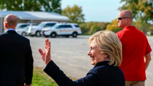 Democratic presidential candidate Hillary Rodham Clinton waves as she departs Wednesday, Oct. 7, 2015, following a campaign stop at the Westfair Amphitheater in Council Bluffs, Iowa. (AP Photo/Nati Harnik)