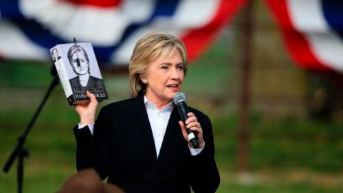 "Democratic presidential candidate Hillary Rodham Clinton holds up her book ""Hard Choices"", as she speaks Wednesday, Oct. 7, 2015, during a campaign stop at the Westfair Amphitheater in Council Bluffs, Iowa. (AP Photo/Nati Harnik)"