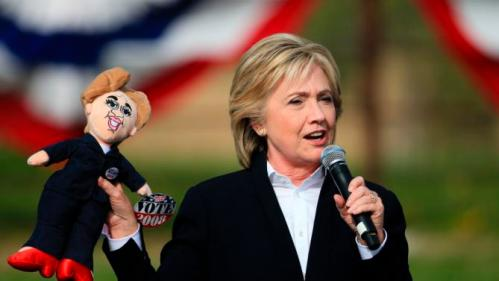 Democratic presidential candidate Hillary Rodham Clinton holds up a doll picked up from a member of the crowd, Wednesday, Oct. 7, 2015, during a campaign stop at the Westfair Amphitheater in Council Bluffs, Iowa. (AP Photo/Nati Harnik)