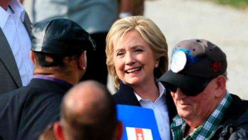 Democratic presidential candidate Hillary Rodham Clinton speaks with members of the audience Wednesday, Oct. 7, 2015, during a campaign stop at the Westfair Amphitheater in Council Bluffs, Iowa. (AP Photo/Nati Harnik)
