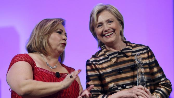 U.S. Democratic presidential candidate Hillary Clinton (R) smiles next to U.S. Representative Linda Sanchez (D-CA) at the Congressional Hispanic Caucus Institute's 38th annual Awards Gala in Washington October 8, 2015. REUTERS/Yuri Gripas