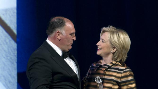 Democratic presidential candidate Hillary Rodham Clinton presents the CHCI Chair's Medallion Award to José Andrés, at the Congressional Hispanic Caucus Institute's 38th Annual Awards Gala at the Washington Convention Center, on Thursday, Oct. 8, 2015, in Washington ( AP Photo/Jose Luis Magana)