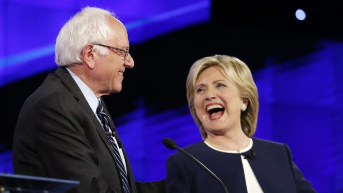 Sen. Bernie Sanders, of Vermont,, left, and Hillary Rodham Clinton laugh during the CNN Democratic presidential debate, Tuesday, Oct. 13, 2015, in Las Vegas. (AP Photo/John Locher)