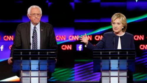 Hillary Rodham Clinton, right, speaks and Sen. Bernie Sanders, of Vermont, looks on during the CNN Democratic presidential debate Tuesday, Oct. 13, 2015, in Las Vegas. (AP Photo/John Locher)
