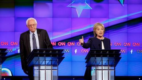 Hillary Rodham Clinton, right, speaks as Sen. Bernie Sanders, of Vermont, looks on during the CNN Democratic presidential debate Tuesday, Oct. 13, 2015, in Las Vegas. (AP Photo/John Locher)