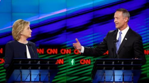 Former Maryland Gov. Martin O'Malley, right, speaks as Hillary Rodham Clinton listens during the CNN Democratic presidential debate Tuesday, Oct. 13, 2015, in Las Vegas. (AP Photo/John Locher)