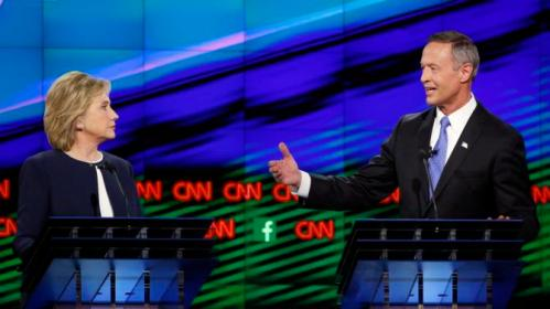 Former Maryland Gov. Martin O'Malley, right, speaks as Hillary Rodham Clinton listens during the CNN Democratic presidential debate Tuesday, Oct. 13, 2015, in Las Vegas. (AP Photo/John Locher)
