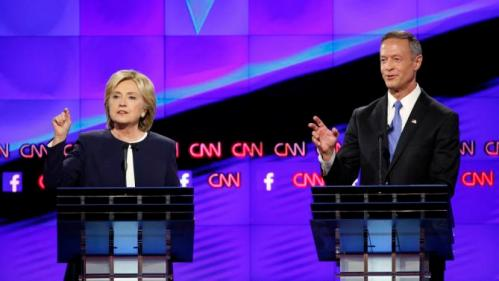 Hillary Rodham Clinton, left, and former Maryland Gov. Martin O'Malley speak during the CNN Democratic presidential debate Tuesday, Oct. 13, 2015, in Las Vegas. (AP Photo/John Locher)