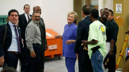 Democratic presidential candidate Hillary Rodham Clinton, center, tours an International Union of Painters and Allied Trades training facility Wednesday, Oct. 14, 2015, in Henderson, Nev. The union announced it's support Wednesday for Clinton's presidential campaign. (AP Photo/John Locher)