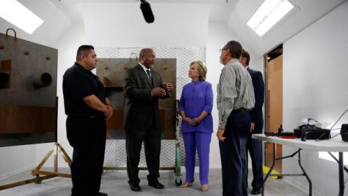 International Union of Painters and Allied Trades general president Kenneth Rigmaiden, second from left, gives Democratic presidential candidate Hillary Rodham Clinton, third from left, a tour of an International Union of Painters and Allied Trades training facility Wednesday, Oct. 14, 2015, in Henderson, Nev. The union announced it's support Wednesday for Clinton's presidential campaign. (AP Photo/John Locher)