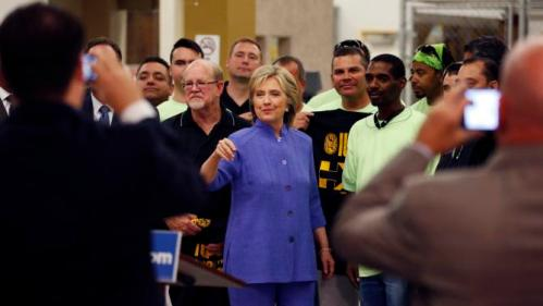 Democratic presidential candidate Hillary Rodham Clinton tours an International Union of Painters and Allied Trades training facility Wednesday, Oct. 14, 2015, in Henderson, Nev. The union announced it's support Wednesday for Clinton's presidential campaign. (AP Photo/John Locher)