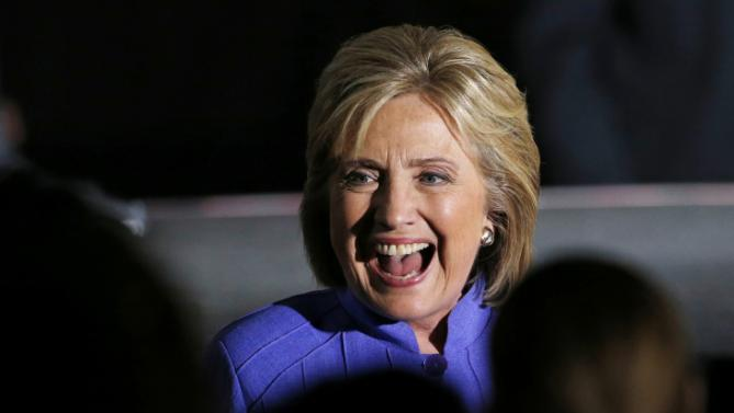 Democratic presidential candidate Hillary Rodham Clinton laughs while meeting with people at a rally Wednesday, Oct. 14, 2015, in Las Vegas. The stop was her last scheduled public event the day after the first Democratic debate. (AP Photo/John Locher)