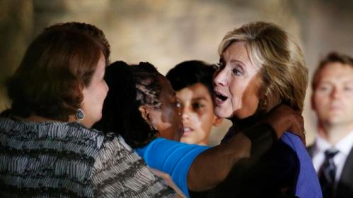 Democratic presidential candidate Hillary Rodham Clinton meets with people during a rally Wednesday, Oct. 14, 2015, in Las Vegas. The stop was her last scheduled public event the day after the first Democratic debate. (AP Photo/John Locher)