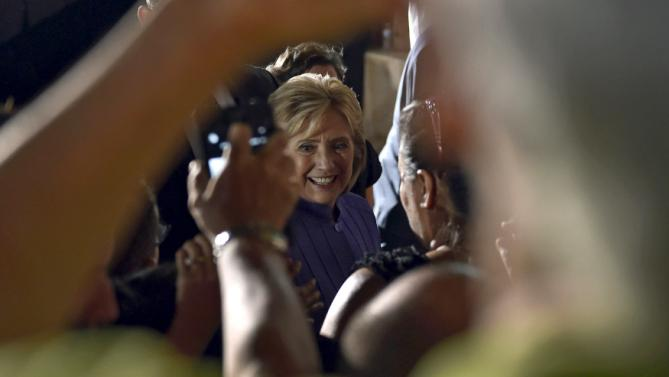 Democratic U.S. presidential candidate Hillary Clinton greets supporters after speaking at a campaign rally at the Springs Preserve in Las Vegas, Nevada, October 14, 2015.   REUTERS/David Becker