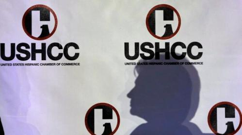 The shadow of Democratic presidential candidate Hillary Rodham Clinton is seen on a banner as she speaks to the United States Hispanic Chamber of Commerce, Thursday, Oct. 15, 2015, in San Antonio. (AP Photo/Eric Gay)