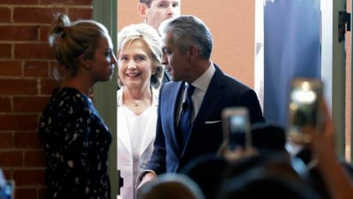 Democratic presidential candidate Hillary Rodham Clinton, center, arrives to speak to the United States Hispanic Chamber of Commerce, Thursday, Oct. 15, 2015, in San Antonio. (AP Photo/Eric Gay)