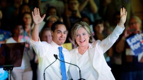 Democratic presidential candidate Hillary Rodham Clinton, right, stands with Housing and Urban Development Secretary Julian Castro, left, after she was introduced during a campaign event, Thursday, Oct. 15, 2015, in San Antonio. (AP Photo/Eric Gay)