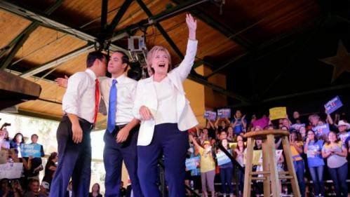Democratic presidential candidate Hillary Rodham Clinton, right, with Housing and Urban Development Secretary Julian Castro, center and his brother, Rep. Joaquin Castro, left, arrives for a campaign event, Thursday, Oct. 15, 2015, in San Antonio. (AP Photo/Eric Gay)