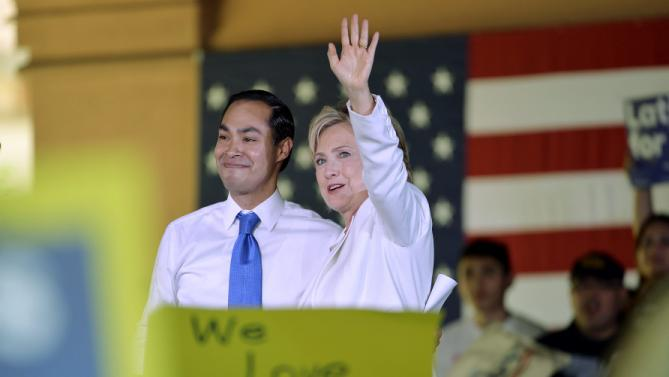 "Democratic U.S. presidential candidate Hillary Clinton waves with U.S. Secretary of Housing and Urban Development Julian Castro at her side during a ""Latinos for Hillary"" rally in San Antonio, Texas October 15, 2015. Castro endorsed Clinton's campaign for president.  REUTERS/Darren Abate"
