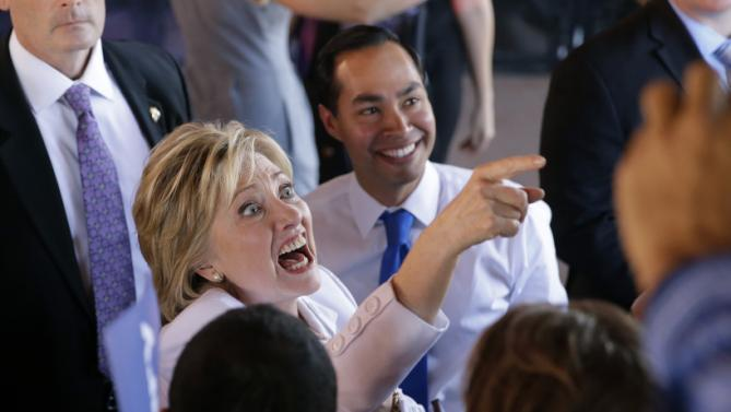 Democratic presidential candidate Hillary Rodham Clinton, left, and Housing and Urban Development Secretary Julian Castro, right, greet supporters during a campaign event, Thursday, Oct. 15, 2015, in San Antonio. (AP Photo/Eric Gay)