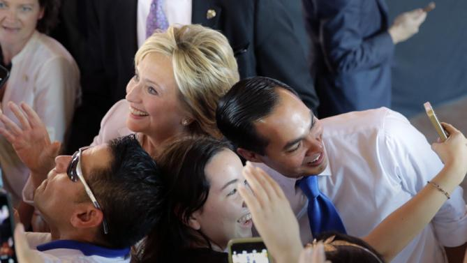 Democratic presidential candidate Hillary Rodham Clinton, left, and Housing and Urban Development Secretary Julian Castro, right, pose for photos with supporters during a campaign event, Thursday, Oct. 15, 2015, in San Antonio. (AP Photo/Eric Gay)