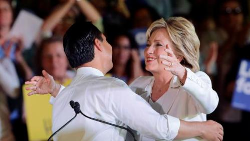 Democratic presidential candidate Hillary Rodham Clinton, right, reaches out to hug Housing and Urban Development Secretary Julian Castro after she was introduced during a campaign event, Thursday, Oct. 15, 2015, in San Antonio. (AP Photo/Eric Gay)