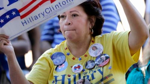 A supporter of Democratic presidential candidate Hillary Rodham Clinton holds a sign during a campaign event, Thursday, Oct. 15, 2015, in San Antonio. (AP Photo/Eric Gay)