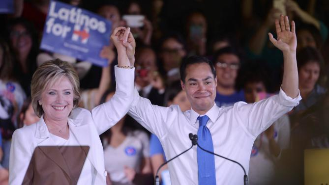 "Democratic U.S. presidential candidate Hillary Clinton holds the hand of HUD Secretary Julian Castro after he endorsed her at a ""Latinos for Hillary"" rally in San Antonio, Texas October 15, 2015.   REUTERS/Darren Abate"