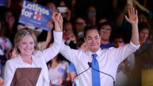 """Democratic U.S. presidential candidate Hillary Clinton holds the hand of HUD Secretary Julian Castro after he endorsed her at a """"Latinos for Hillary"""" rally in San Antonio, Texas October 15, 2015. REUTERS/Darren Abate"""