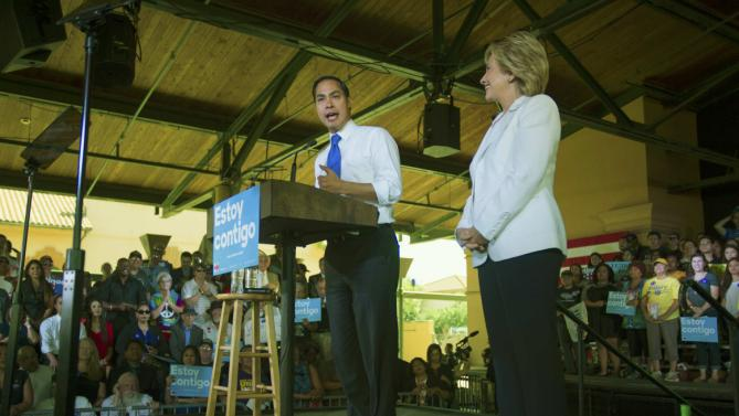 "U.S. Department of Housing and Urban Development Secretary Julian Castro (L) endorses Democratic U.S. presidential candidate Hillary Clinton during a ""Latinos for Hillary"" rally in San Antonio, Texas October 15, 2015.  REUTERS/Darren Abate"
