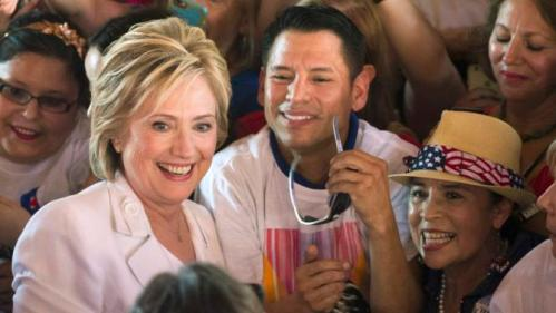 """Democratic U.S. presidential candidate Hillary Clinton poses with supporters after a """"Latinos for Hillary"""" rally in San Antonio, Texas October 15, 2015. REUTERS/Darren Abate"""