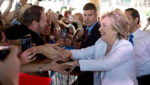 """Democratic U.S. presidential candidate Hillary Clinton greets supporters at the conclusion of a """"Latinos for Hillary"""" rally in San Antonio, Texas October 15, 2015. REUTERS/Darren Abate"""