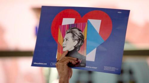 "A Clinton supporter holds up a sign while waiting for Democratic U.S. presidential candidate Hillary Clinton to speak during a ""Latinos for Hillary"" rally in San Antonio, Texas October 15, 2015. REUTERS/Darren Abate"