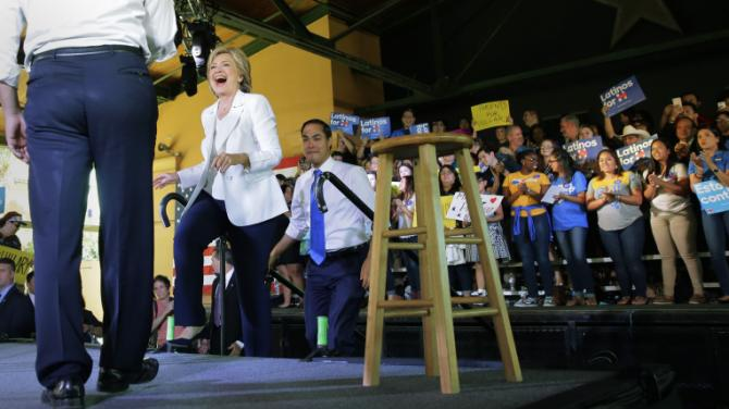 Democratic presidential candidate Hillary Rodham Clinton, center, arrives with Housing and Urban Development Secretary Julian Castro, right,  and Rep. Joaquin Castro, left, at a campaign event, Thursday, Oct. 15, 2015, in San Antonio. (AP Photo/Eric Gay)