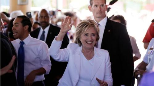Democratic presidential candidate Hillary Rodham Clinton, right, and Housing and Urban Development Secretary Julian Castro, left, arrive for a campaign event, Thursday, Oct. 15, 2015, in San Antonio. (AP Photo/Eric Gay)