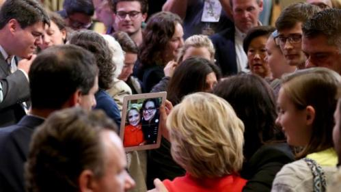 Democratic presidential candidate Hillary Rodham Clinton poses for a photo with a potential supporter after a town hall meeting, Friday, Oct. 16, 2015, in Keene, N.H. (AP Photo/Mary Schwalm)