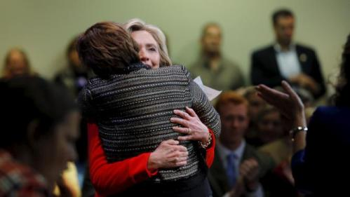 U.S. Democratic presidential candidate Hillary Clinton hugs Clai Lasher-Sommers, a survivor of domestic abuse and gun violence, at a campaign town hall meeting in Keene, New Hampshire October 16, 2015. REUTERS/Brian Snyder