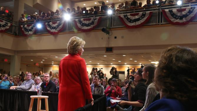 Democratic presidential candidate Hillary Rodham Clinton leans on a railing as she listens to a question during a town hall meeting Friday, Oct. 16, 2015, in Keene, N.H. (AP Photo/Mary Schwalm)