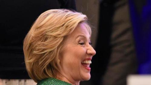 Democratic presidential candidate Hillary Rodham Clinton laughs before she speaks during a meeting of the Alabama Democratic Conference in Hoover, Ala., Saturday, Oct. 17, 2015. (AP Photo/ Mark Almond)