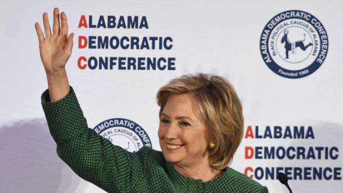 Democratic presidential candidate Hillary Rodham Clinton waves as she speaks during a meeting of the Alabama Democratic Conference in Hoover, Ala., Saturday, Oct. 17, 2015. Clinton tells black Alabama Democrats that she'd champion voting rights in the White House. She says Republicans are dismantling the progress of the civil rights movement. (AP Photo/ Mark Almond)