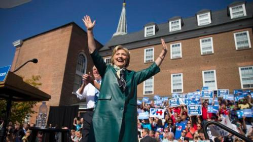 Democratic presidential candidate, former Secretary of State Hillary Rodham Clinton, accompanied by Virginia Gov. Terry McAuliffe, smiles and waves as she arrive for a campaign rally in Alexandria, Va., Friday, Oct. 23, 2015. (AP Photo/Evan Vucci)