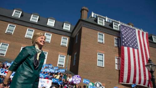 Democratic presidential candidate, former Secretary of State Hillary Rodham Clinton smiles as she arrives for a campaign rally, Friday, Oct. 23, 2015, in Alexandria, Va. (AP Photo/Evan Vucci)