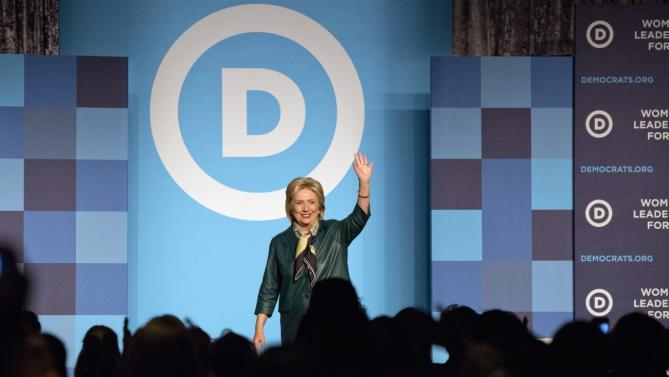 Democratic presidential candidate, former Secretary of State Hillary Rodham Clinton waves after speaking to the Democratic National Committee 22nd Annual Women's Leadership Forum National Issues Conference in Washington, Friday, Oct. 23, 2015. (AP Photo/Jacquelyn Martin)